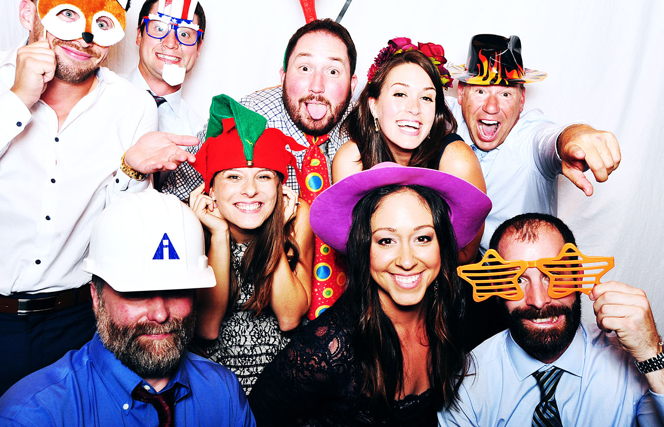 People at a party in a photobooth having a good time
