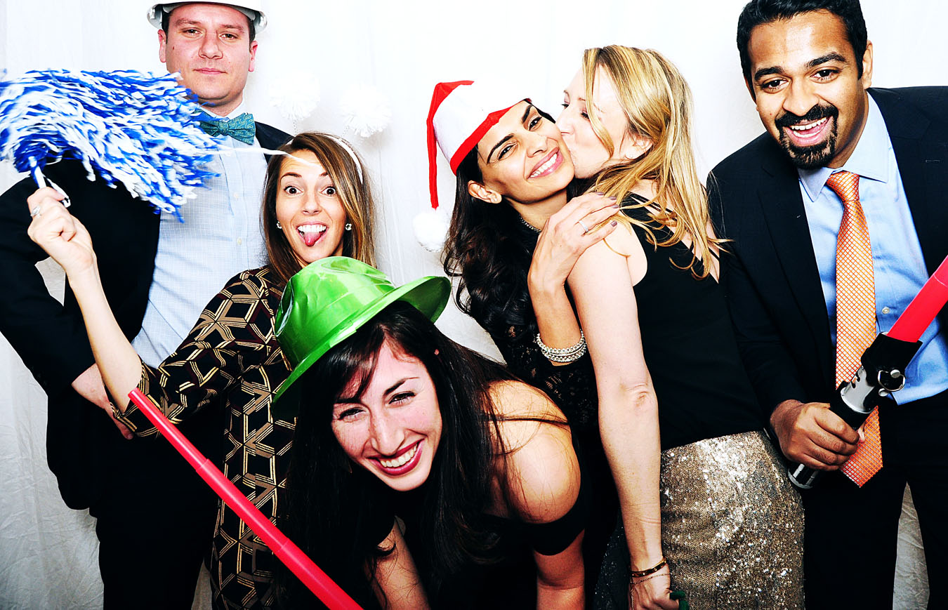 holiday party photobooth image of people using props and having fun